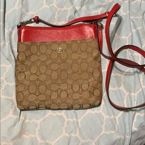 Tan and red coach crossbody